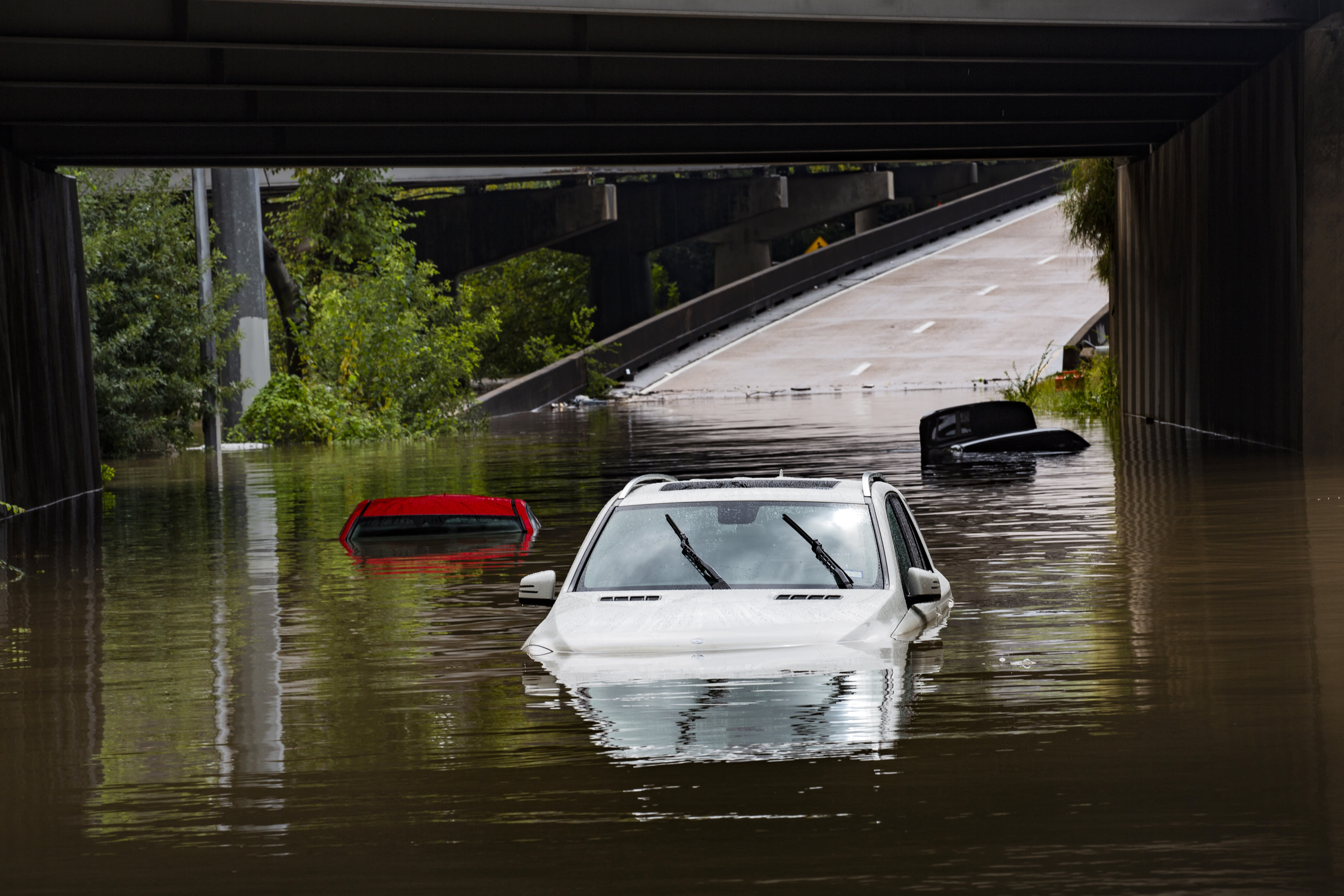 Cars stranded on high flood waters on Houston Ave. exit from Interstate 45 during Tropical Storm Beta Tuesday, Sept. 22, 2020, in Houston. Beta has weakened to a tropical depression as it parked itself over the Texas coast, raising concerns of extensive flooding in Houston and areas further inland. (Marie D. De Jesus/Houston Chronicle via AP)