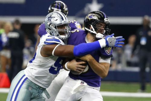Cowboys lineman David Irving sacks Ravens quarterback Joe Flacco last season. (AP)