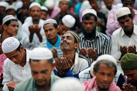 A Rohingya refugee man cries as he take part in Eid al-Adha prayer near the Kutupalang makeshift refugee camp, in Cox's Bazar, Bangladesh, September 2, 2017. REUTERS/Mohammad Ponir Hossain