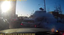 Dashcam captures car flying over snow bank