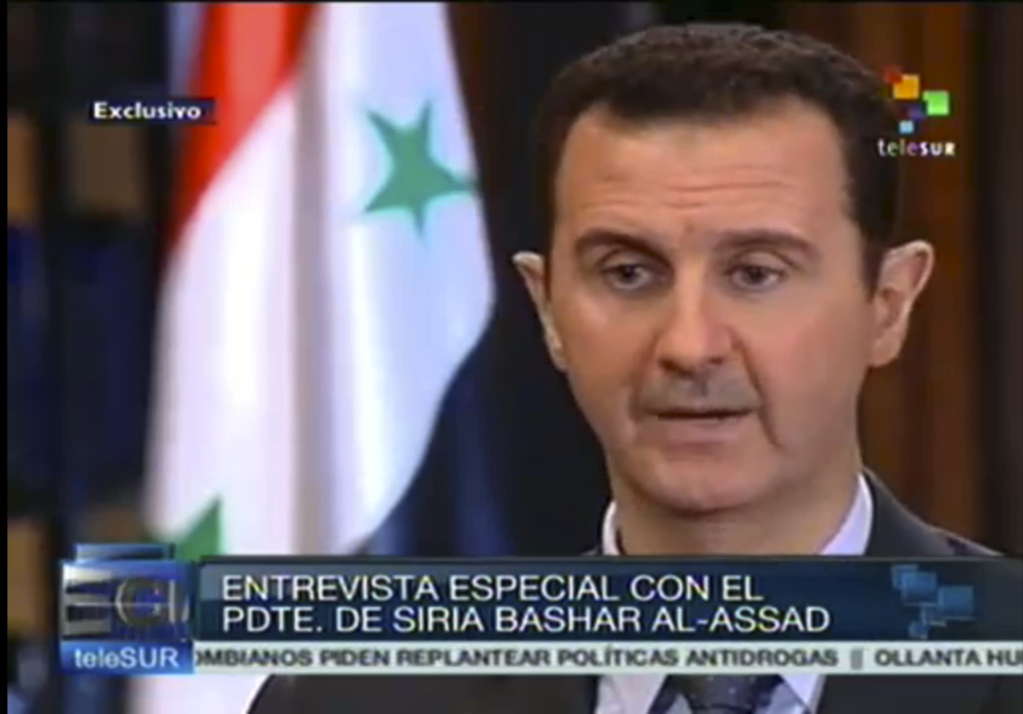 In this frame grab taken from online video broadcast on Telesur television on Wednesday, Sept. 25, 2013, Syria's President Bashar Assad speaks during an interview with a Telesur reporter in Damascus, Syria. Telesur is a Latin American news channel financed primarily by Venezuela's government. (AP Photo/Telesur)