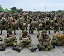 Russia orders troops back from occupied Crimea and border with Ukraine