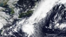 Storm heading northward toward Japan packing winds, downpour