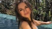Elizabeth Hurley, 53, wears string bikini while frolicking in the pool in sexy new video: 'How on earth do you still look 25?'