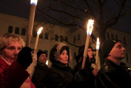 Demonstrators take part in a protest organised by a Jewish group against a planned statue of Balint Homan in Szekesfehervar