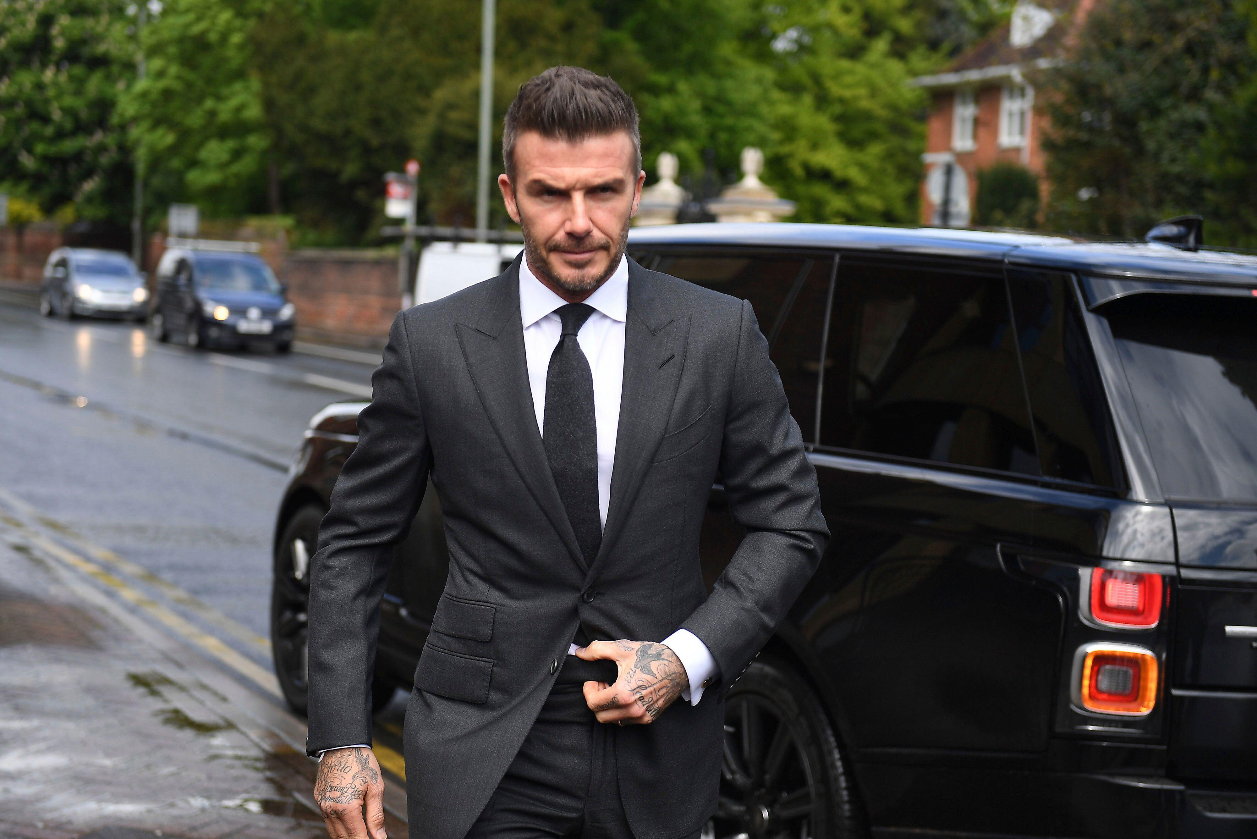 968aea2ed356 David Beckham loses driver's license for 6 months after using phone while  driving
