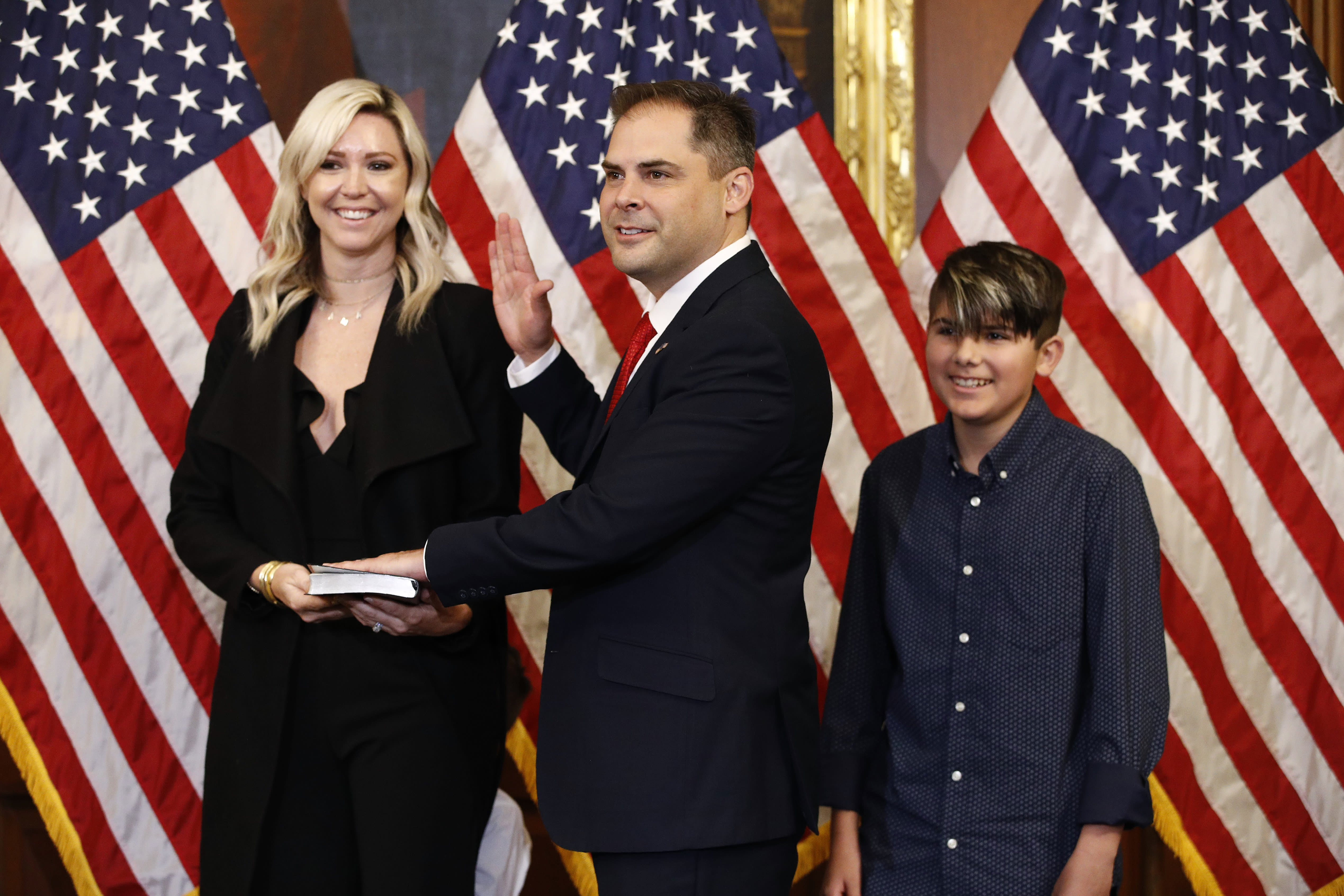 R-Calif. center joined by his wife Rebecca and son Preston participates in a ceremonial swearing-in on Capitol Hill in Washington. Garcia who in a May special election became the first Republic