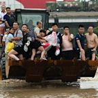 China floods: Mother dies after saving baby from mudslide as death toll rises to 51