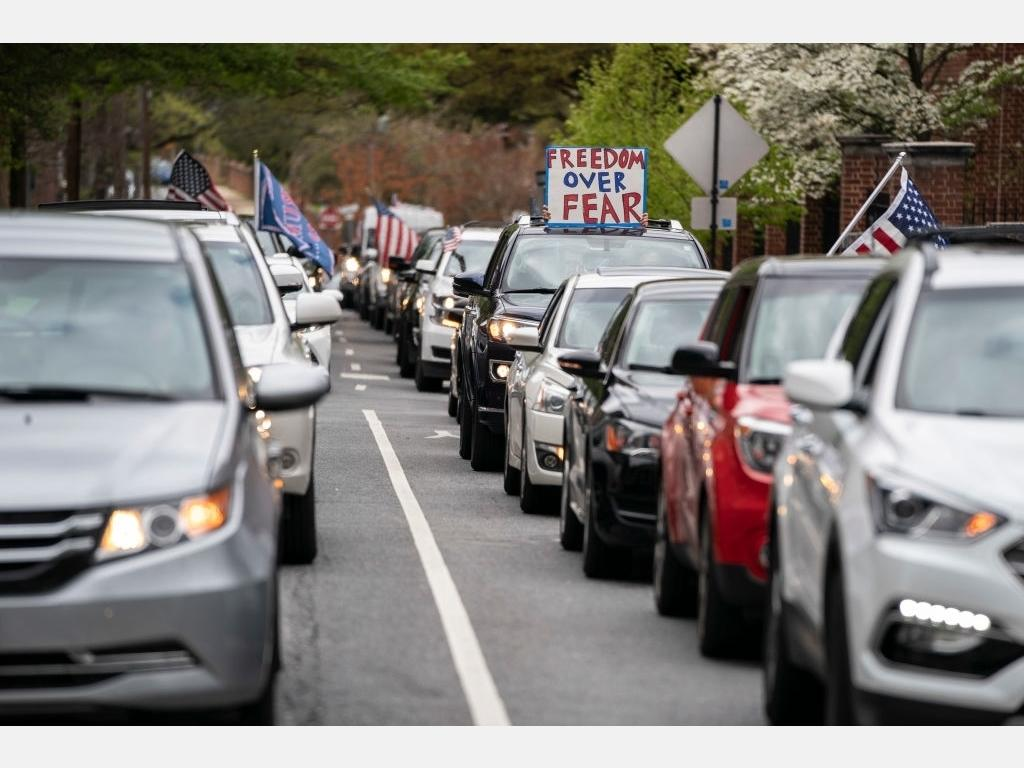 Protesters with the group Reopen Maryland rally near the State House to call on the state to lift the stay-at-home order and reopen the economy on April 18 in Annapolis. Most protestors rallied from inside their cars as they caused gridlock