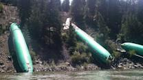 Plane parts tossed into river after train derailment
