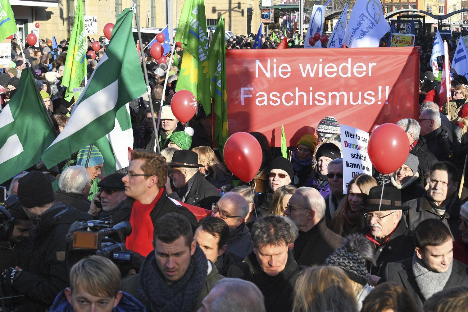 "People demonstrate against a meeting of European nationalists in Koblenz, Germany, Saturday, Jan. 21, 2017. Dutch populist anti-Islam lawmaker Geert Wilders, AfD (Alternative for Germany) chairwoman Frauke Petry, far-right leader and candidate for next spring presidential elections Marine le Pen from France and Italian Lega Nord chief Matteo Salvini will attend the meeting. Banner reads ""Never again Fascism"". (Boris Roessler/dpa via AP)"