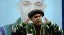 Muted reaction to Afghan poll result despite warlord's rallying cry