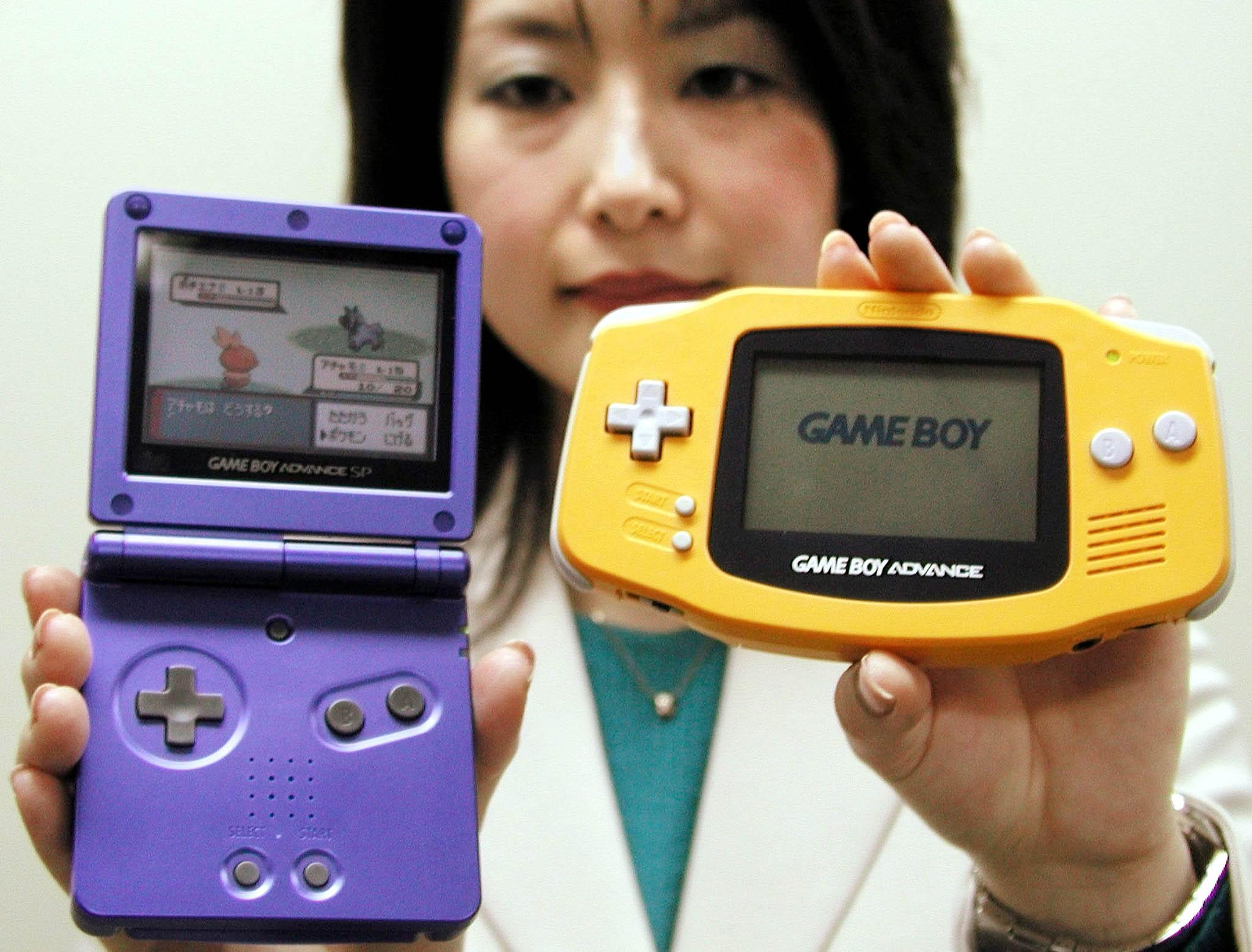 A Nintendo Co employee displays the company's new Game Boy Advance SP (L) and the current version in Osaka, western Japan, on January 7, 2003. Japan's videogame giant said on Tuesday that it would launch the premium version of its Game Boy Advance hand-held videogame player, which can be folded and has a lighting system that allows it to be used in poorly lit places, on February 14 for 12,500 yen ($105) in Japan.