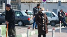Iran's neighbours impose travel bans as coronavirus toll rises