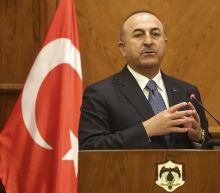 Turkey warns as Syrian government poised to enter Afrin