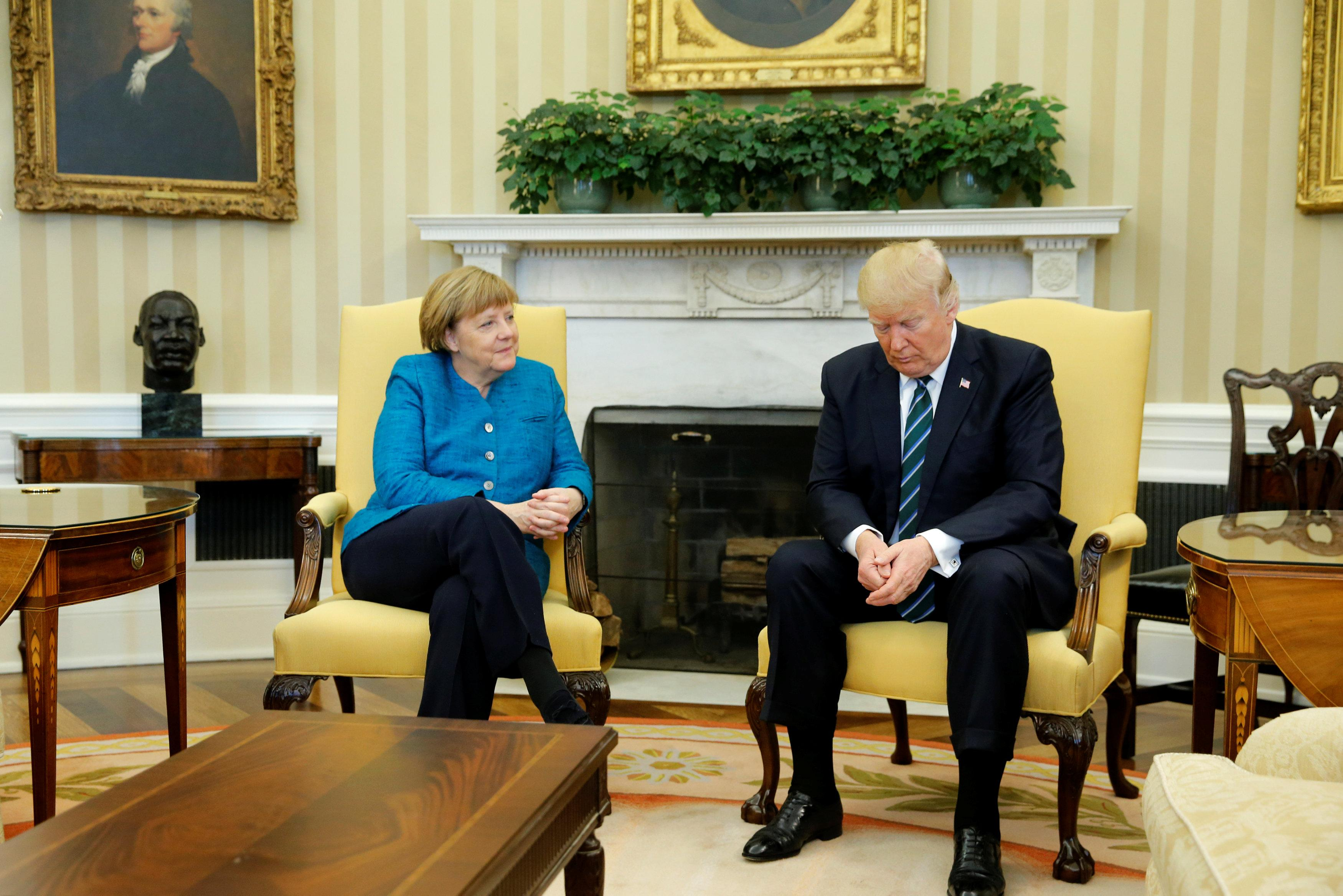 U.S. President Donald Trump and Germany's Chancellor Angela Merkel wait for reporters to enter the room before their meeting in the Oval Office at the White House in Washington, U.S. March 17, 2017. REUTERS/Jonathan Ernst