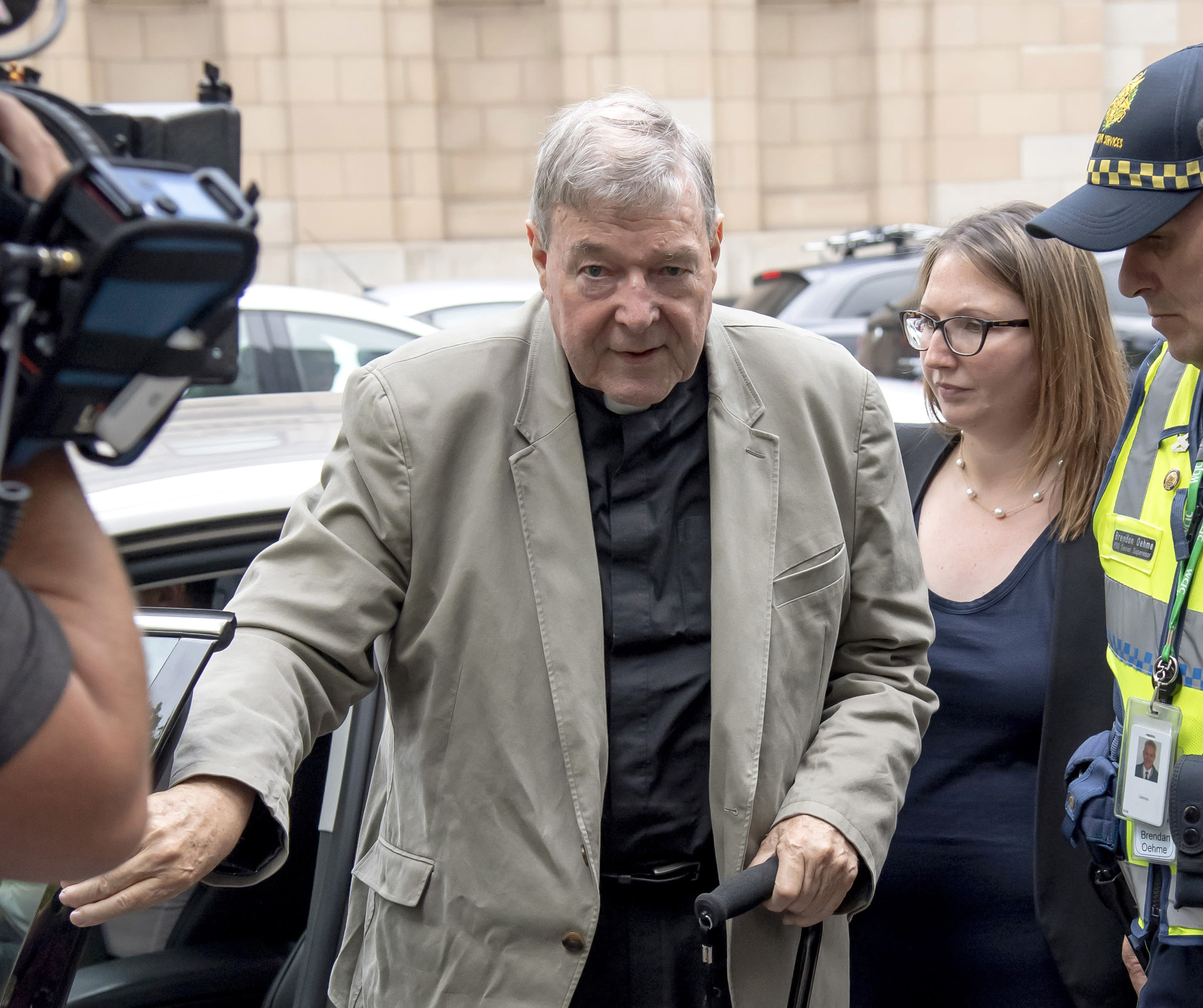 FILE - In this Feb. 26, 2019, file photo, Cardinal George Pell arrives at the County Court in Melbourne, Australia. Pell, Pope Francis' former finance minister, will soon return to the Vatican during an extraordinary economic scandal for the first time since he was cleared of child abuse allegations in Australia five months ago, a newspaper has reported, Monday, Sept. 28, 2020. (AP Photo/Andy Brownbill, File)