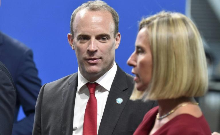 British Foreign Minister Dominic Raab (L) and EU diplomatic chief Federica Mogherini are pictured in Helsinki, Finland on August 29