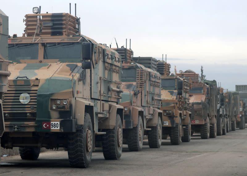 Turkish military vehicles are seen in Hazano near Idlib