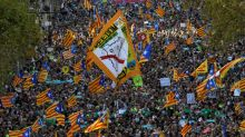 How is Spain taking control of Catalan powers?