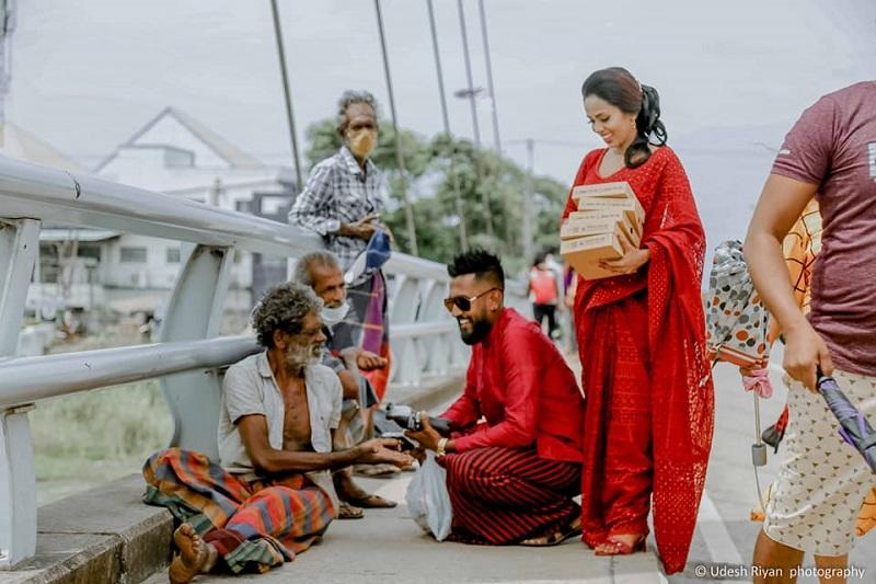 Sri Lankan bride and groom distribute Pizza Hut, Coca-Cola to the homeless to celebrate wedding day