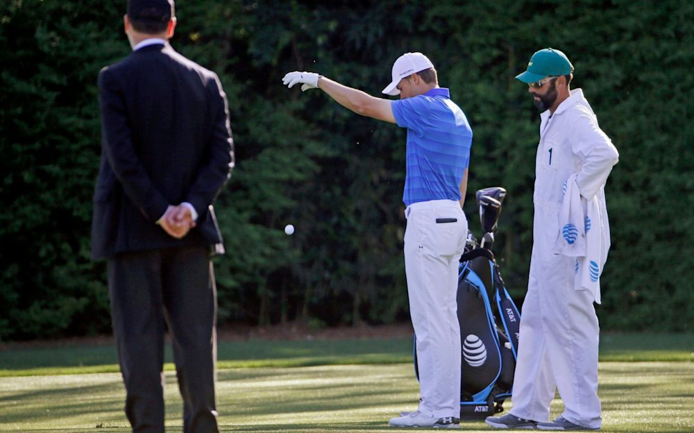 Jordan Spieth's Masters challenge fell apart when he put two balls in Rae's Creek at the 12th - AP