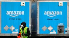 Exclusive: Amazon to deploy masks and temperature checks for workers by next week