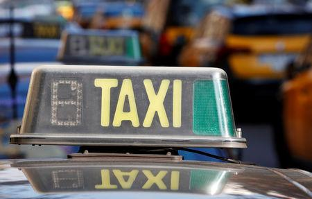 FILE PHOTO - A taxi sign is seen during during a strike against the VTC regulation, in Barcelona