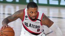 Damian Lillard scores 51 points as Portland Trail Blazers beat Philadelphia 76ers to keep playoff hopes alive