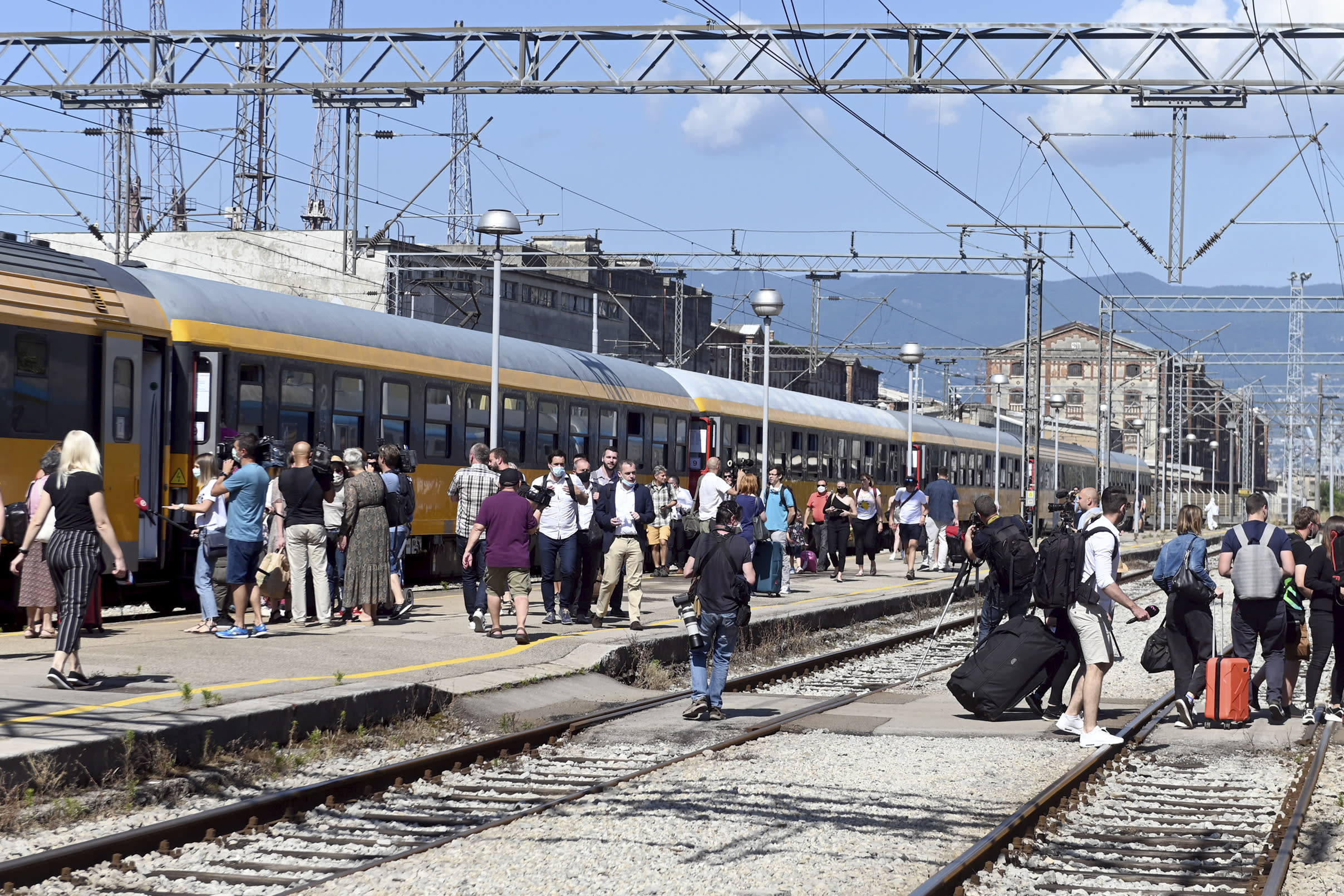 Passengers disembark from a train that arrived from the Czech Republic in Rijeka, Croatia, Wednesday, July 1, 2020. A train carrying some 500 tourists from the Czech Republic has arrived to Croatia as the country seeks to attract visitors after easing lockdown measures against the new coronavirus.(AP Photo)