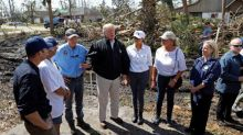Trump surveys Michael's wrath, rescuers search for bodies