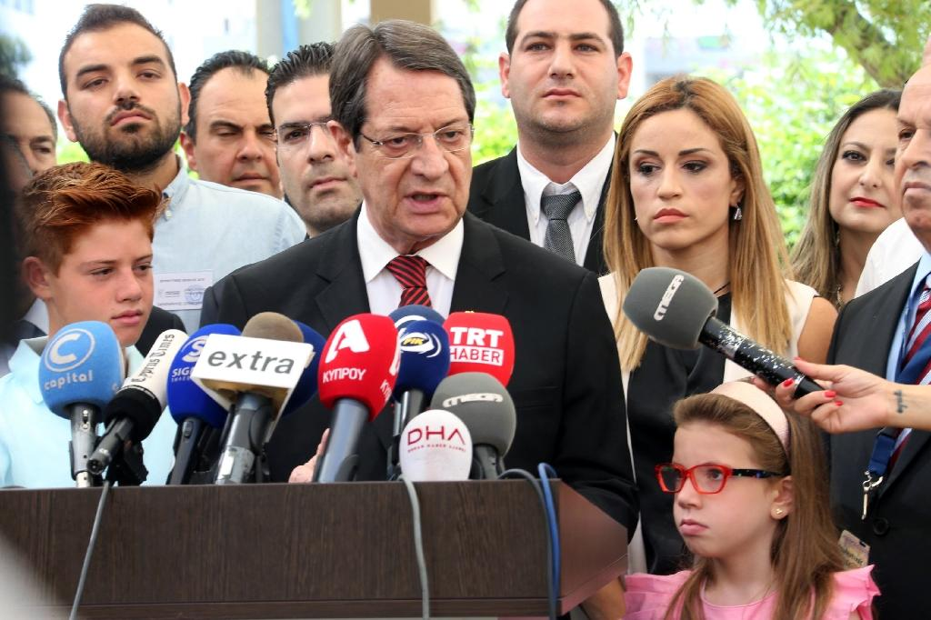 The rightwing Democratic Rally (DISY) of Cypriot President Nicos Anastasiades (pictured, C) has taken 30 percent of the vote and 18 seats in the 56-seat parliament, down two on the last election in 2011 (AFP Photo/Stavros Ioannides)