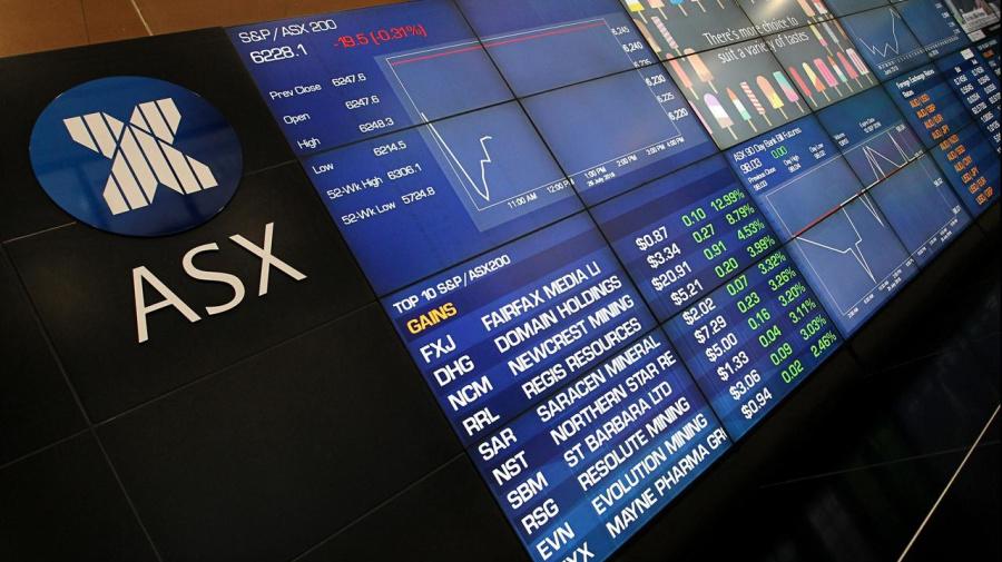 Aust shares edge higher despite bank falls