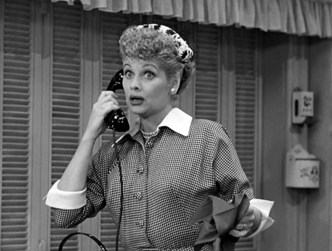 American actress and comedienne Lucille Ball (1911 - 1989) (left), as Lucy Ricardo, talks on the telephone in a scene from an episode of the television comedy 'I Love Lucy' entitled 'Job Switching,' Los Angeles, California, May 30, 1952. The episode was originally broadcast as the opening episode of the show's second season, on September 15, 1952. (Photo by CBS Photo Archive/Getty Images)