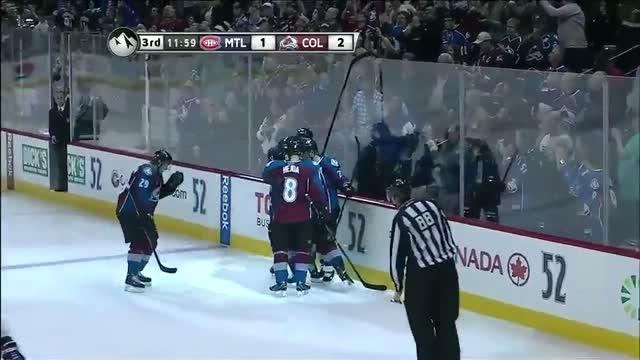 Nathan MacKinnon buries the backhander