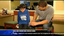 Local kids receive new athletic shoes