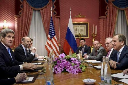 U.S. Secretary of State John Kerry and Russia's Foreign Minister Sergei Lavrov wait for a meeting at the Beau Rivage Palace Hotel in Lausanne