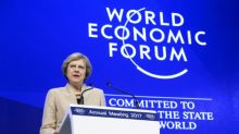 May vows 'open' Britain as banks shift jobs from London