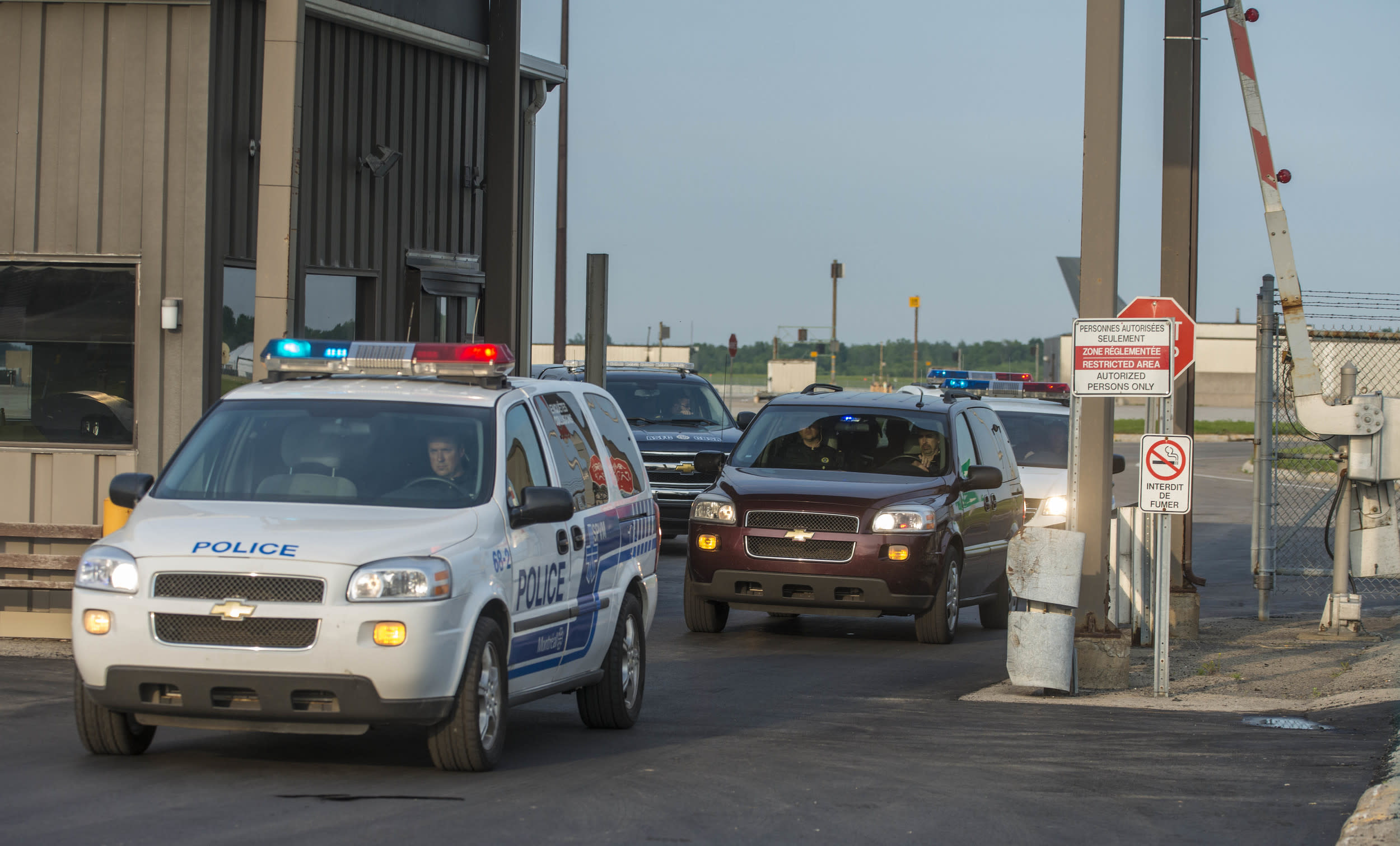 A police convoy carrying  porn actor Luka Rocco Magnotta, dubbed 'the Canadian Psycho',  departs  Mirabel Airport outside Montreal on June 18, 2012 in Mirabel, Quebec, Canada.   Magnotta, who arrived on board a Canadian military plane, is accused of slaying and dismembering a Chinese student in Montreal last month, before fleeing to Europe.   AFP PHOTO / ROGERIO BARBOSA        (Photo credit should read ROGERIO BARBOSA/AFP/GettyImages)