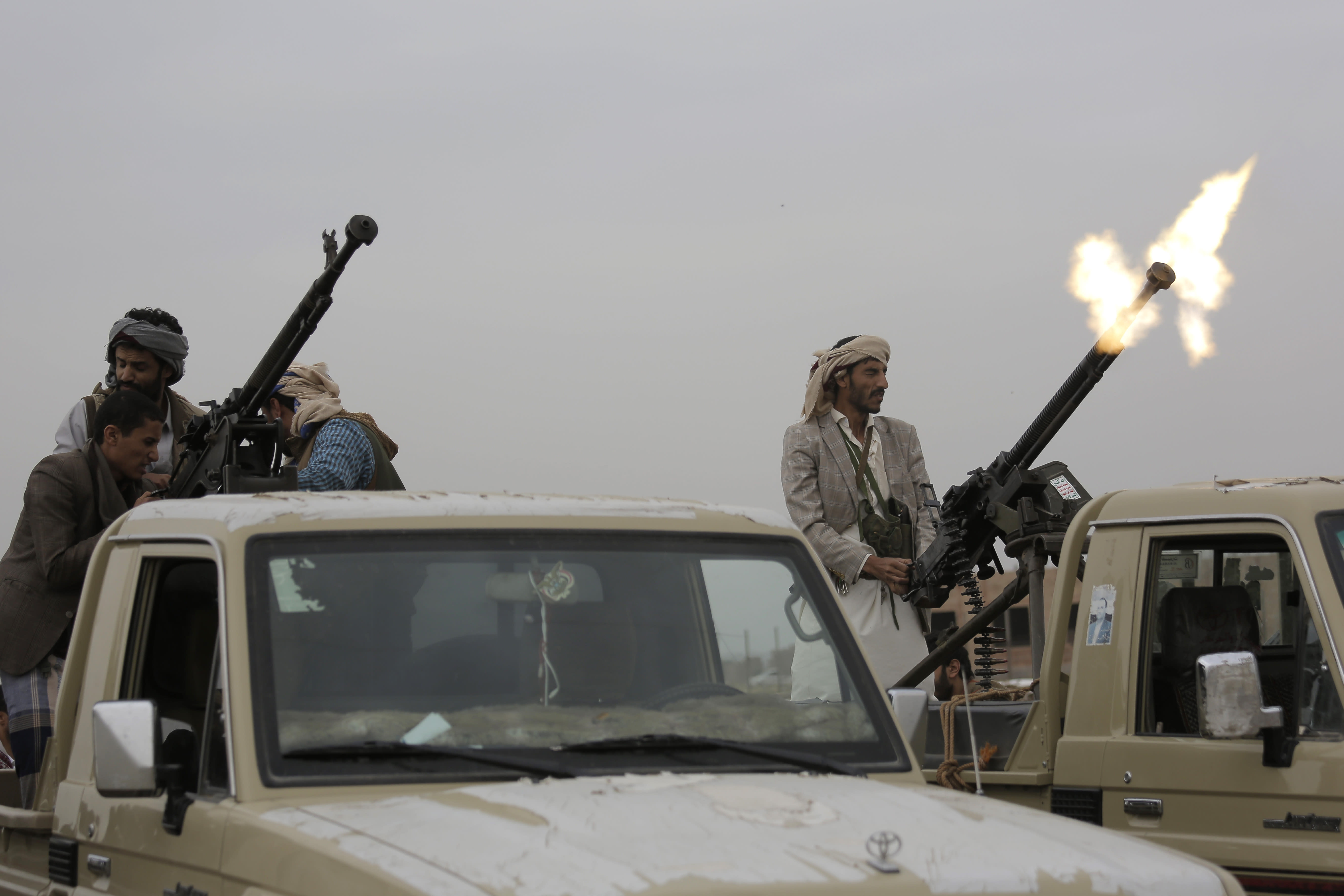 A Houthi rebel fighter fires in the air during a gathering aimed at mobilizing more fighters for the Houthi movement, in Sanaa, Yemen, Thursday, Aug. 1, 2019. The conflict in Yemen began with the 2014 takeover of Sanaa by the Houthis, who drove out the internationally recognized government. Months later, in March 2015, a Saudi-led coalition launched its air campaign to prevent the rebels from overrunning the country's south. (AP Photo/Hani Mohammed)