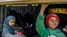 Syria force evacuates women, children from IS holdout