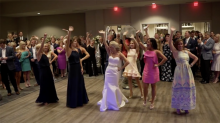 Cheerleader Bride and Squad Perform Spirited Wedding Dance Wearing Heels