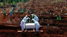 Indonesian gravediggers under strain as COVID-19 burials surge in Jakarta