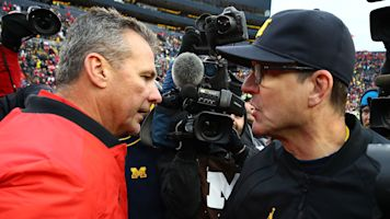 Jim Harbaugh takes swipe at Urban Meyer