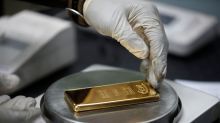 Gold rises to nine-year peak on stimulus bets, silver soars