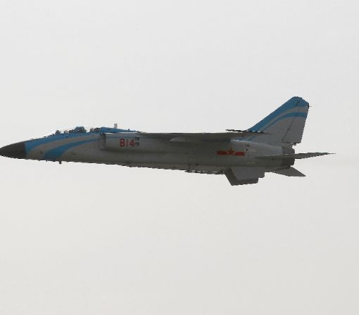 China flies military planes over strait near Japan