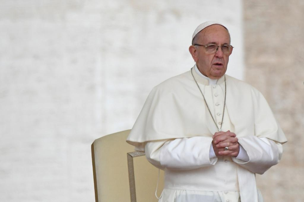 Pope Francis prays during a weekly general audience in St Peter's square on May 23, 2018 in Vatican