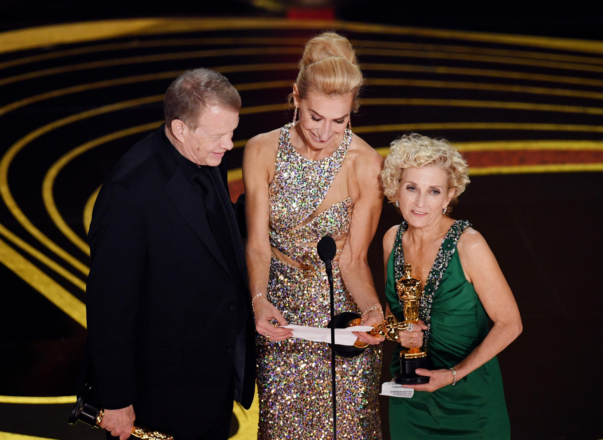 HOLLYWOOD, CALIFORNIA - FEBRUARY 24: (L-R) Greg Cannom, Kate Biscoe, and Patricia Dehaney accept the Makeup and Hairstyling award for 'Vice' onstage during the 91st Annual Academy Awards at Dolby Theatre on February 24, 2019 in Hollywood, California. (Photo by Kevin Winter/Getty Images)