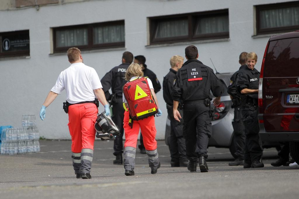 Emergency services arrive at the scene where a woman was found dead in Wiesbaden, on August 12, 2015