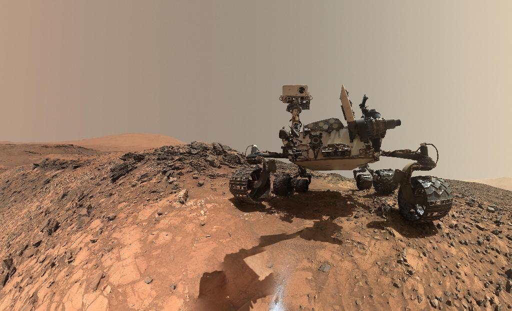 """This NASA photo released June 7, 2018 shows a low-angle self-portrait of NASA's Curiosity Mars rover vehicle at the site from which it reached down to drill into a rock target called """"Buckskin"""" on lower Mount Sharp"""